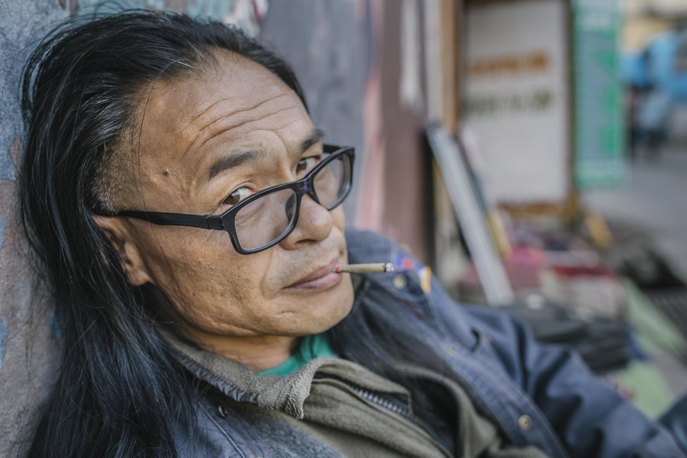 Mesib Norbu, former monk, writer and part of Free Tibet movement outside the poetry tea shop he runs in Mcleod Ganj, Himachal Pradesh, India.
