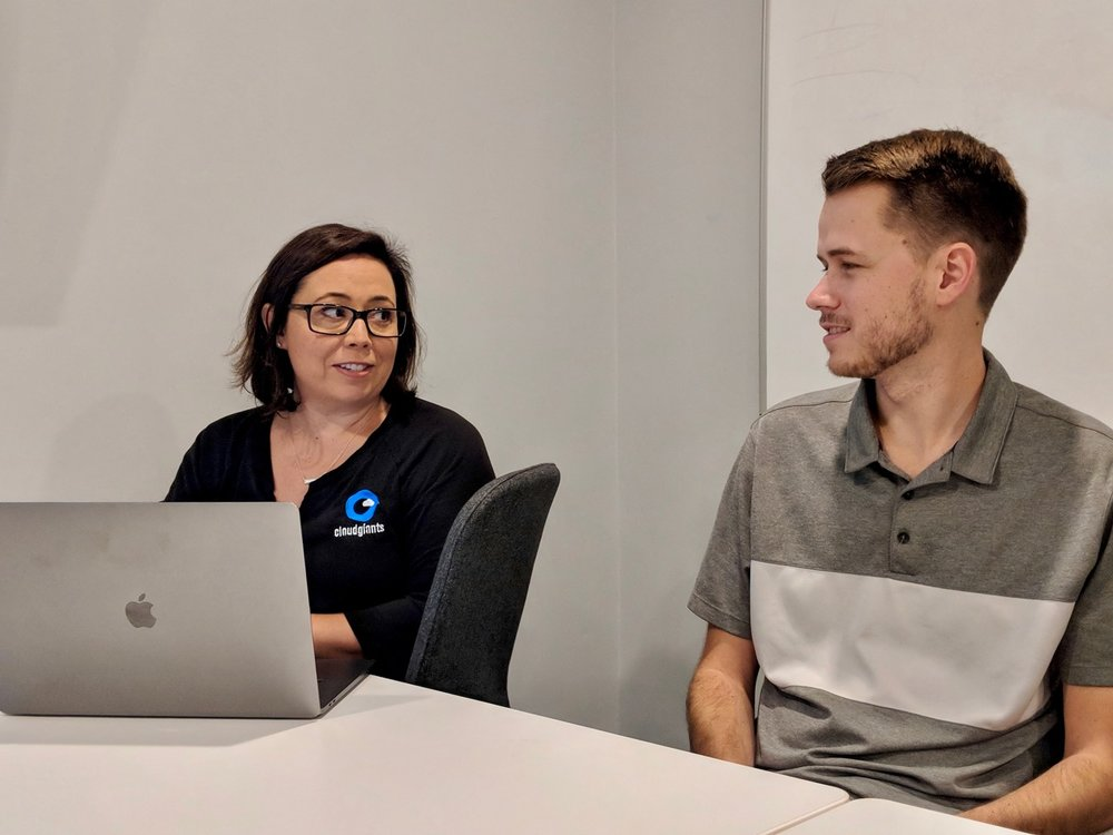 CEO Kelly Pfrommer working with Cloud Giant Grant Mangum.