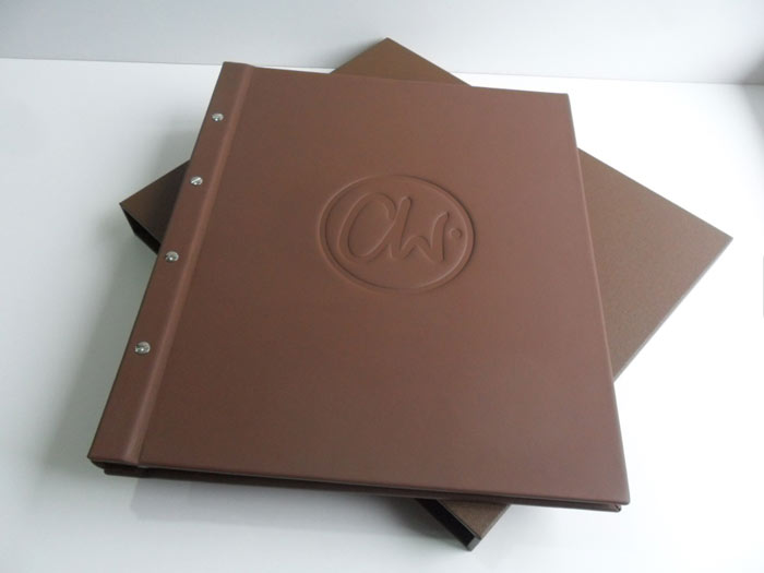 Leather post bound with blind embossing, clear sleeves and slipcase