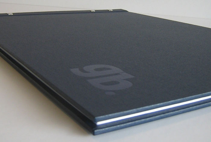 Post bound covers with navy foil