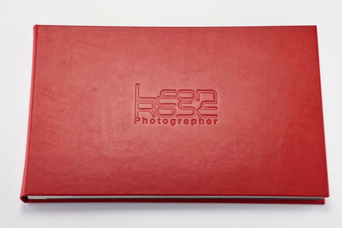 Leather post bound folder,with blind embossing and mounted pages. Image courtesy of  Leon Rose