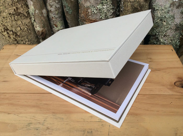 Box folder with post bound pages and heat transfer on front