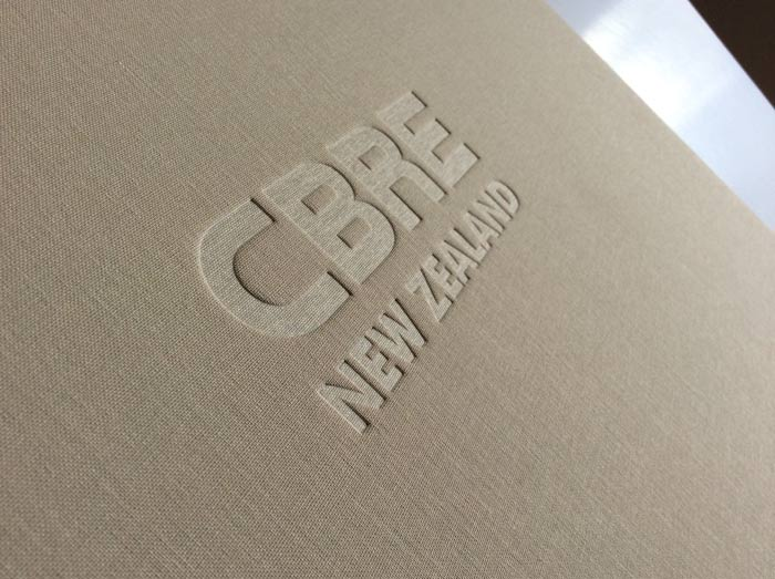 Blind embossing on post bound portfolio