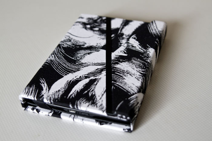 Kindle cover with ribbon detailing and magnetic closure. Photo courtesy of  Milana Photography