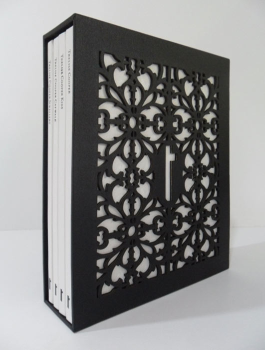 Perfect bound books with black gloss foiling and laser cut slipcase