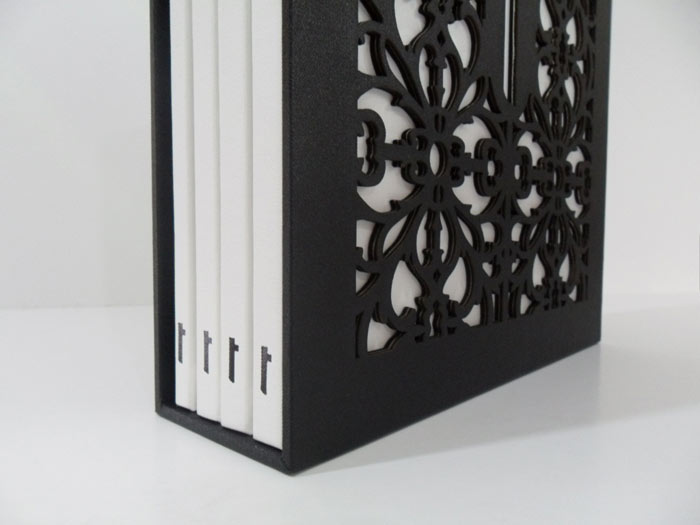 Black gloss foil on white book cloth, laser cut slipcase