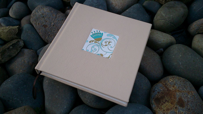 Sewn book, deckled page edges (cover: leather, embossed inlay)