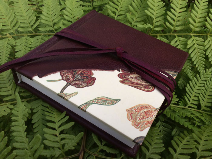 Sewn book (cover: leather, strapping)
