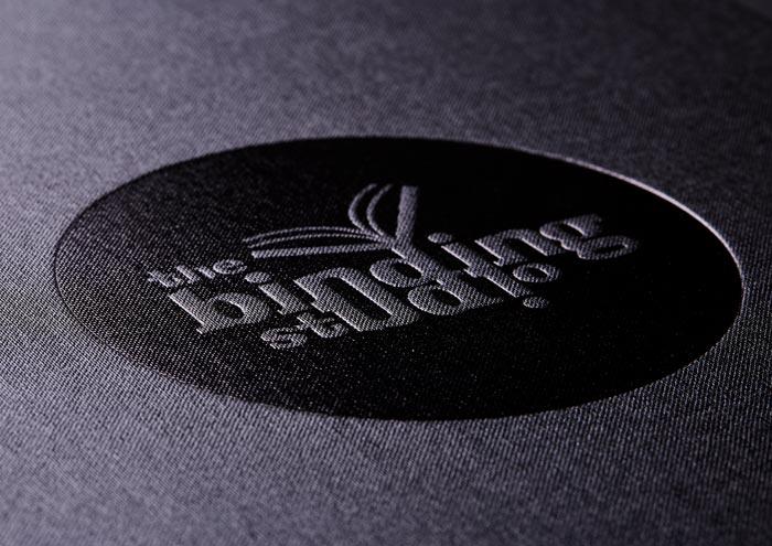 the_binding_studio_marketing_black_gloss_foil.jpg