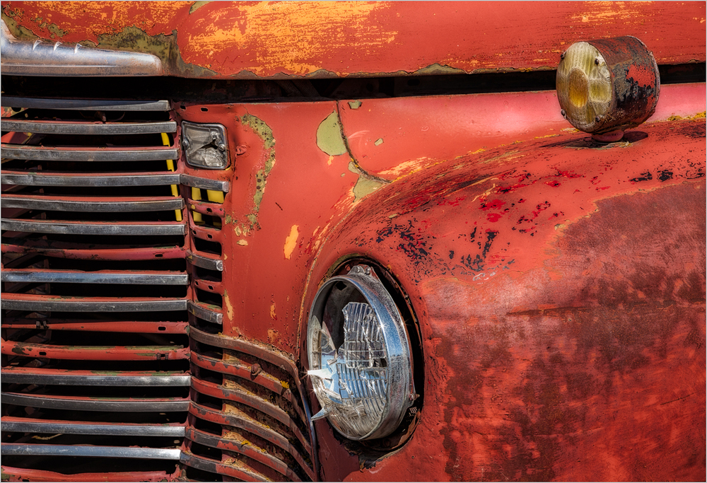 An old truck in a 'car and truck graveyard' in The Palouse