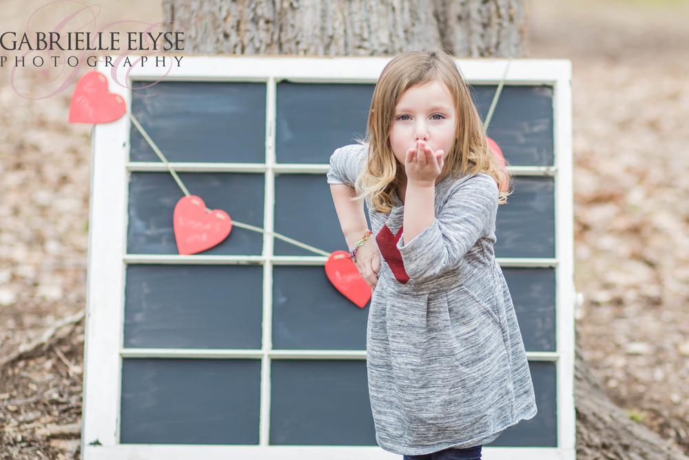 girl blowing kisses cary nc
