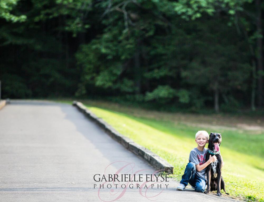 boy and dog at park