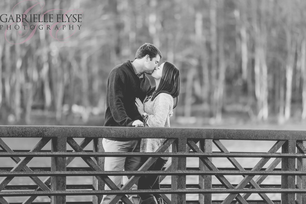black and white bridge kiss