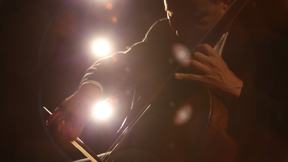 A still from the video interstitials, featuring cellist  Udi Bar-David