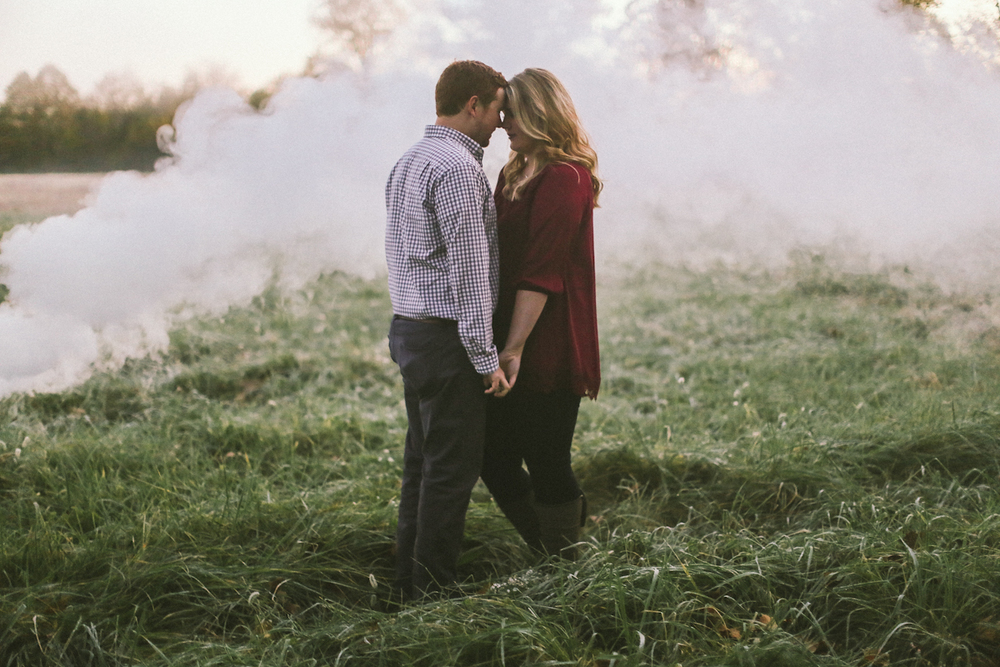 sunrise engagement in field with smoke kentucky photographer