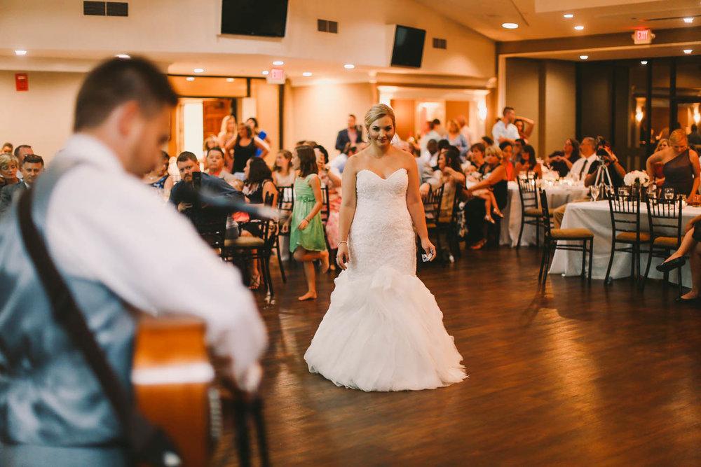 Fasig-tipton-summer-kentucky-wedding-groom-performs-at-reception-699.jpg