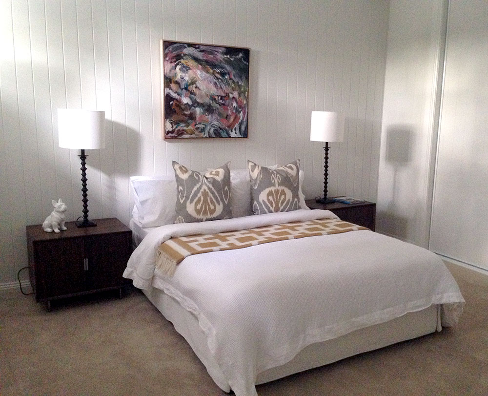 "My painting ""Learning to Soar"" hangs here in this bedroom styled by Coco Republic in a Sherwood house designed and built by my husband Todd of ZieglerBuild."