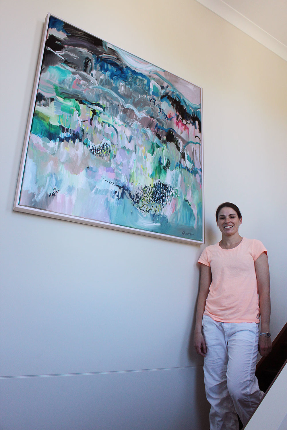"Tahnee in her home stairwell where the title piece from my 2015 solo show ""Moments in Spontaneum"" hangs"