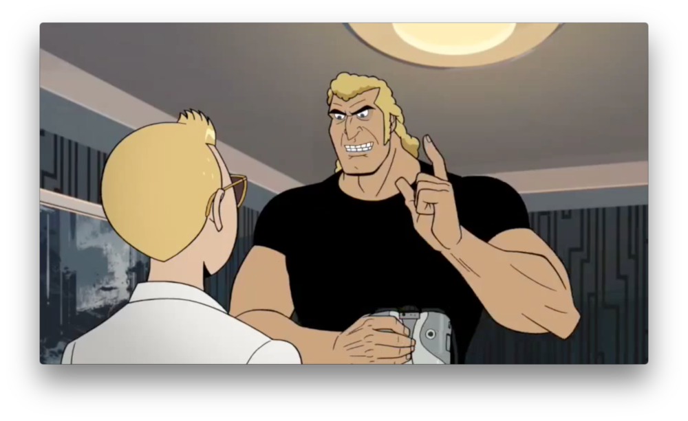 Brock is happy to speak to Hank again, holding some sort of tablet device, or binoculars maybe?