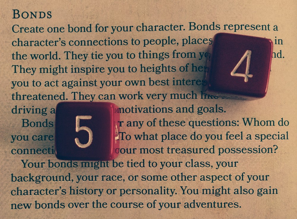 """Bonds"" section in the Player's Handbook with red dice and a classy filter."