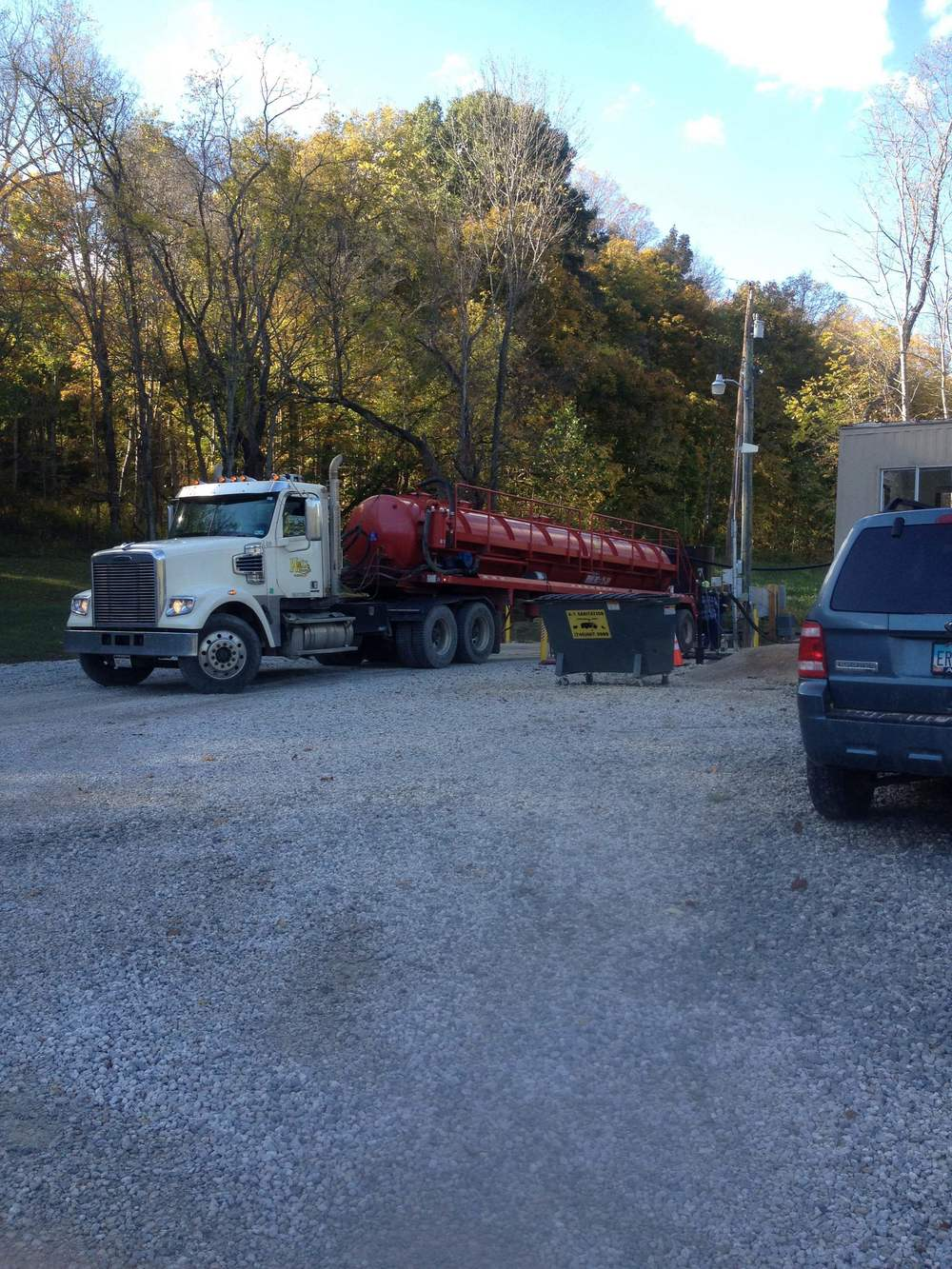 Truck unloading brine into the injection well.