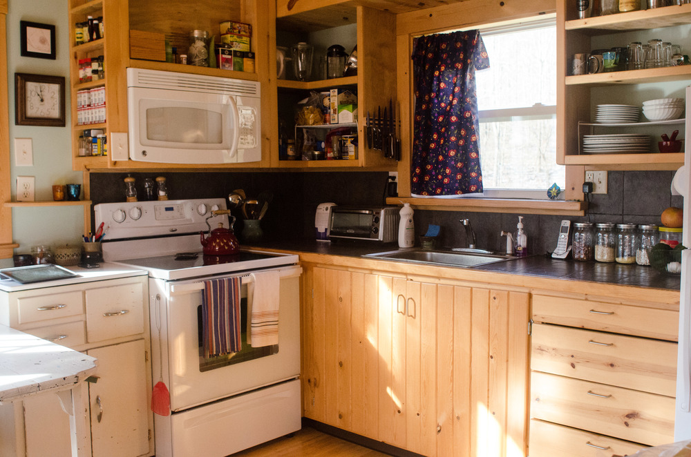 Photo by Kate Hiller — Laura O'Neil's fully functional kitchen in her 300-square-foot home.