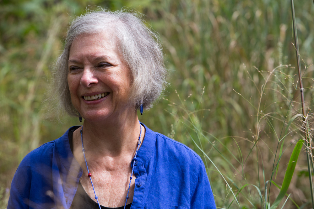 Davidson sits for a portrait among the prairie portion of her garden. Photo by Alexandria Polanosky.