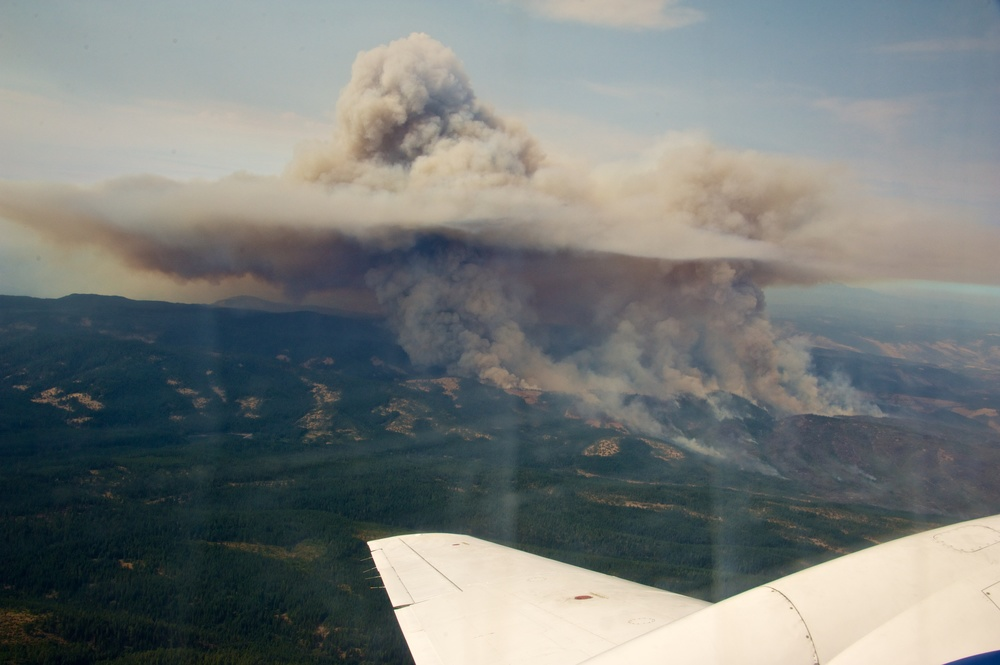 Photo taken by Sedlacek from the plane as it circles a massive wildfire plum in Washington state in 2013.