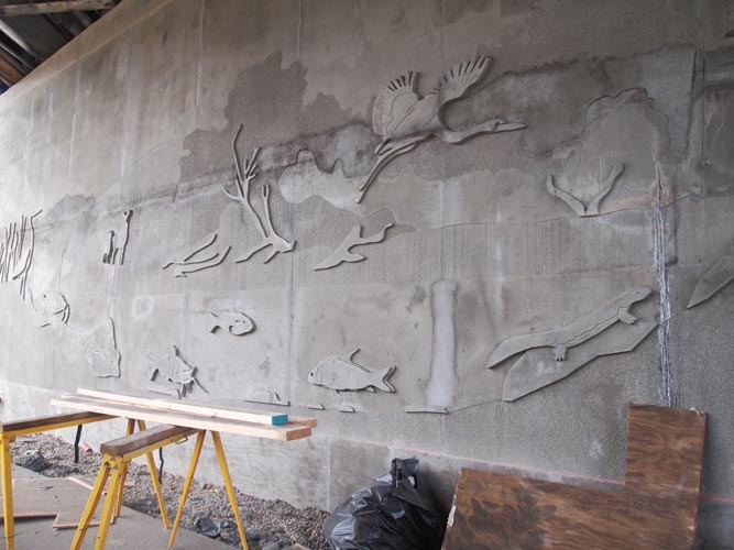 Work on a wildlife mural continues under the Oxbow Bridge on Richland Avenue. The mural depicts animals that have been known to inhabit the area in both past and present. (Olivia Raney)