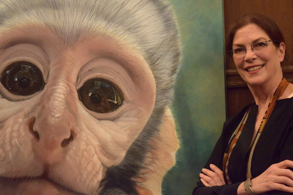 Huffman alongside her portrait of Kecksie, a vervet monkey. Cassie Kelly