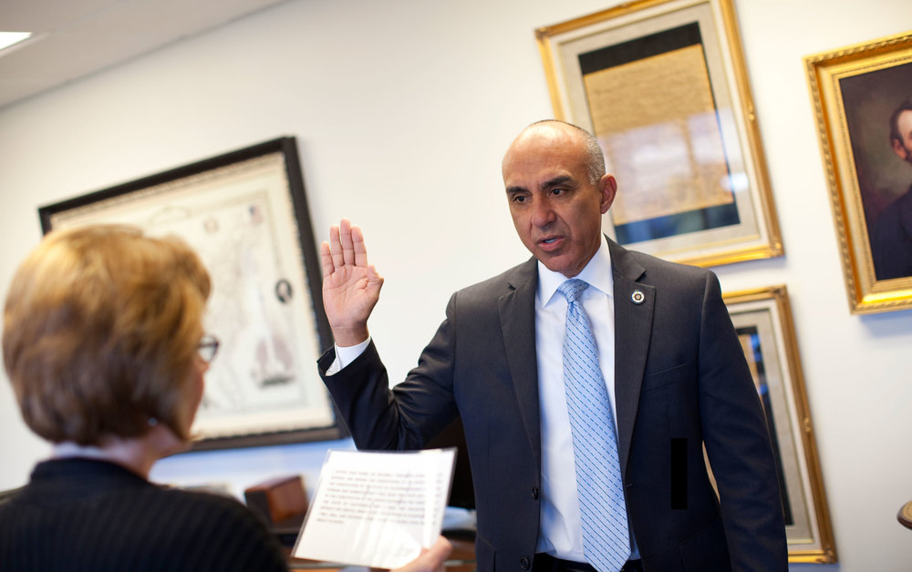 The Clerk of the Board administers the Oath of Office to District Attorney Mike Ramos