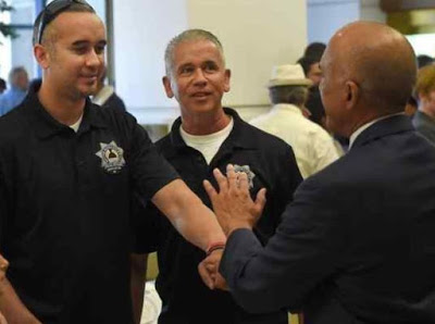 Former San Bernardino Police Officers Gabe Garcia and his father Ron Garcia, talk with San Bernardino County District Attorney Michael A. Ramos at the conclusion of the fourth annual National Crime Victims' Rights Week Memorial on Monday at San Bernardino County Government Center. National Crime Victims' Rights Week is from April 2-8. JOHN VALENZUELA — STAFF PHOTOGRAPHER