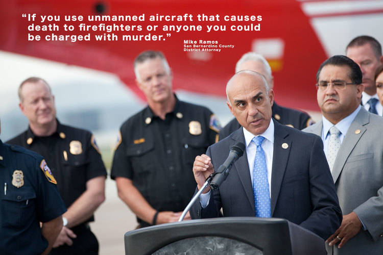 District Attorney Mike Ramos speaks during a news conference at the U.S. Forest Service Airtanker Base at San Bernardino International Airport about the consequences against those drone operators who interfere with fire personnel.