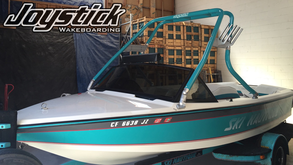teal wakeboard tower on a 1990 ski nautique