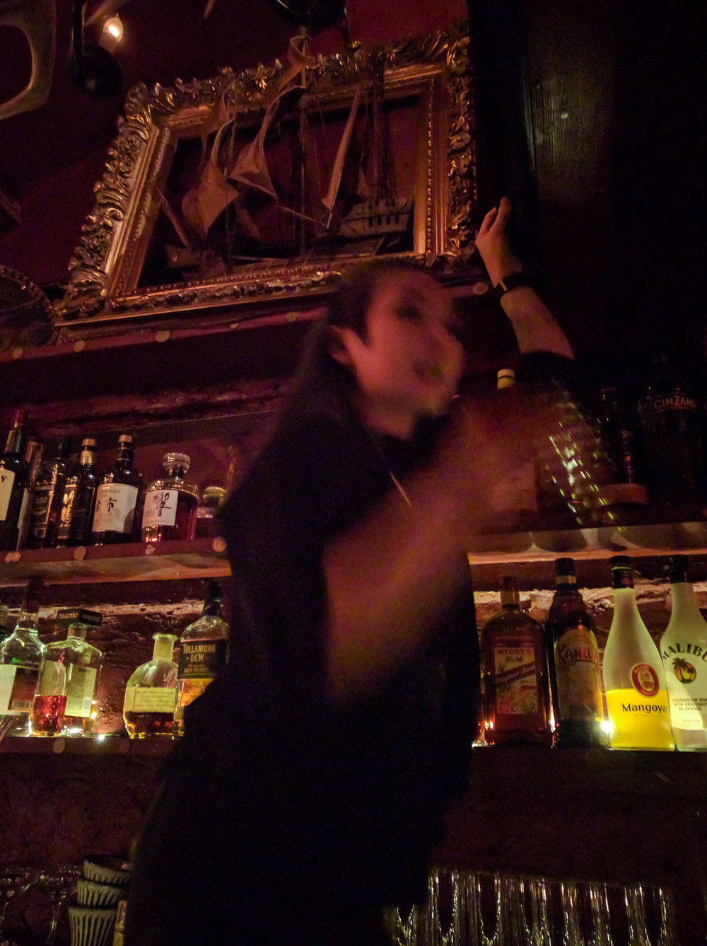Serving drinks from the 2nd to 3rd floors in the Bar Albatross in Golden Gai