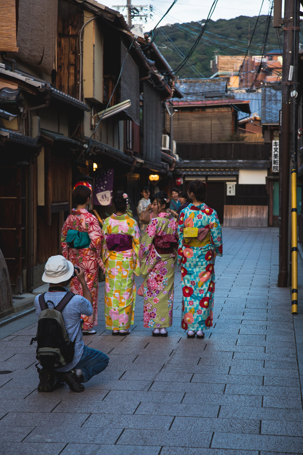 Young teenagers living out the geisha fantasy, and experiencing minor celebrity, in Gion