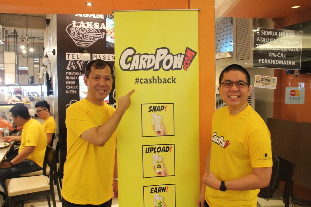 Posing at the CardPow! launch, co-founders Charles Wong (left) and Sze Jun King (right) at a restaurant in Citta Mall.