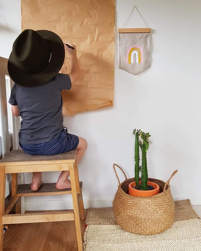Mini Picasso showing off his skills during the school holidays. PLUS eye spy our new rainbow 🌈 wall hanging made from a beautiful beige linen. Online now check it 💛 #xanderandlou #rainbow #love