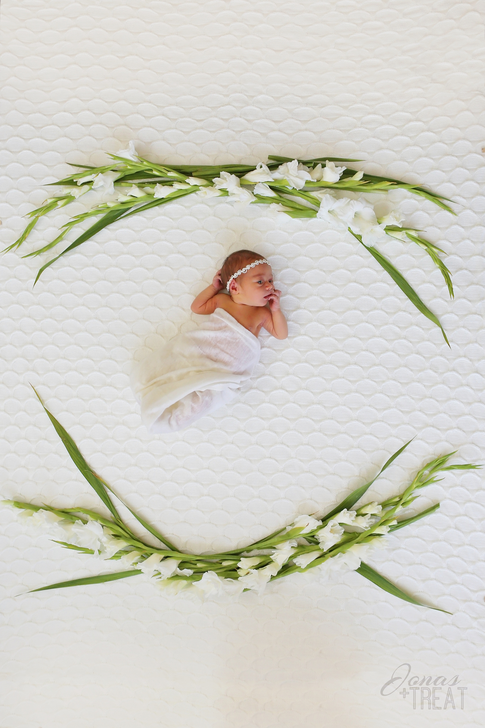 This summer it's blooming babies! Phoenix newborn photography with real flowers. Newborn sessions with real flowers. Newborn with fresh white flowers.