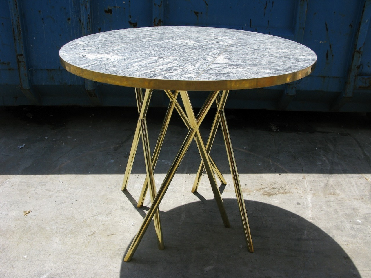 Bar table we have designed for Overeasy, fabricated from polished brass and marble top with brass inserts.