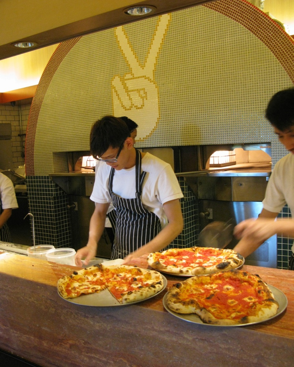 The first pizzas are out the oven.