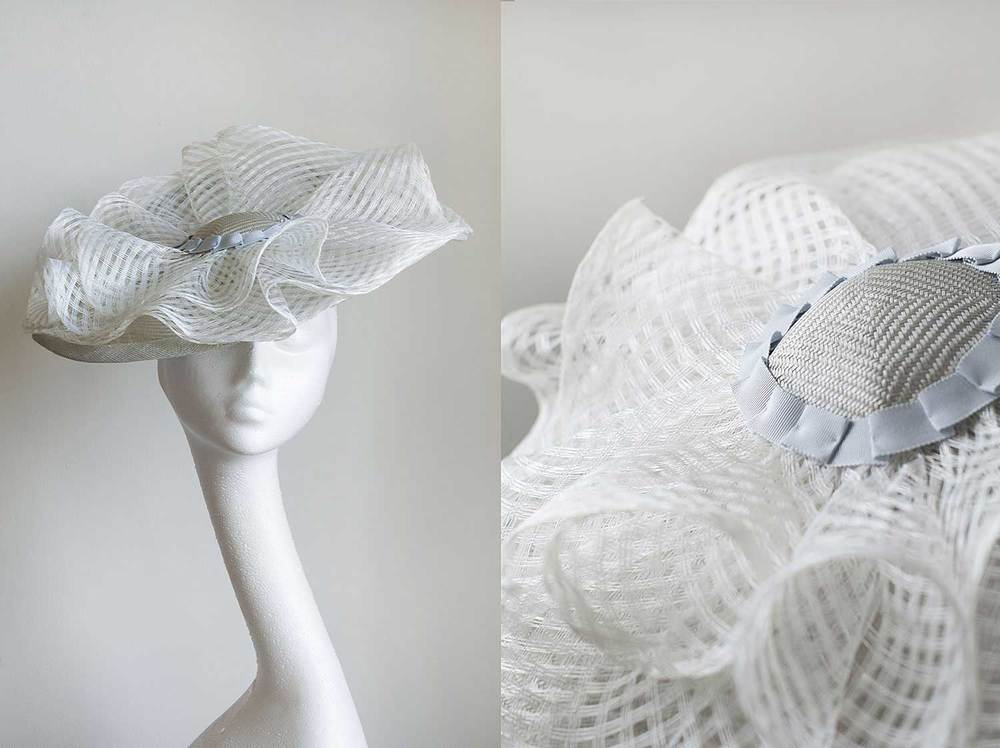 Penny  - a pale blue hat with white windowpane sinamay curls