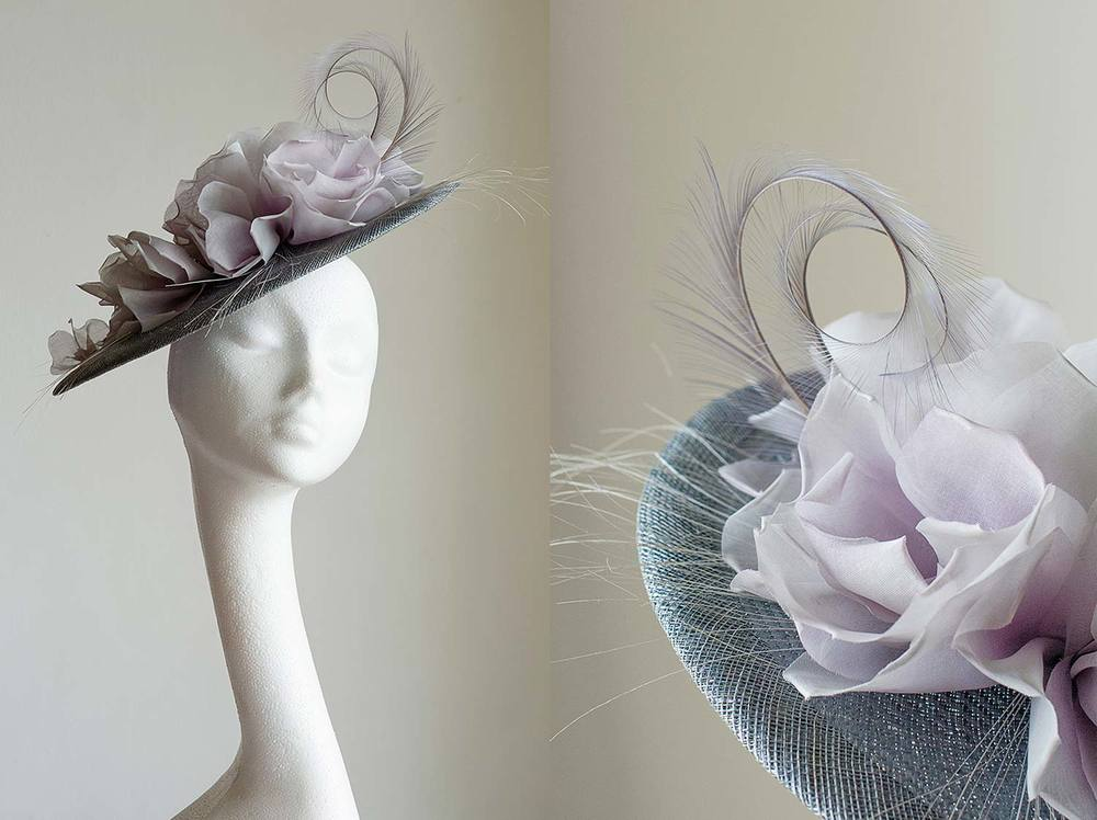 Mavis   -   Grey straw hat with lilac hand made roses, burnt ostrich and pheasant feathers