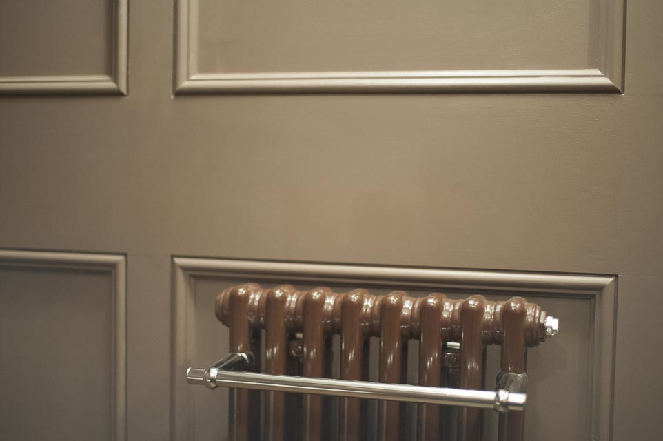 Panelled Wall and Cast Iron Heated Towel Rail