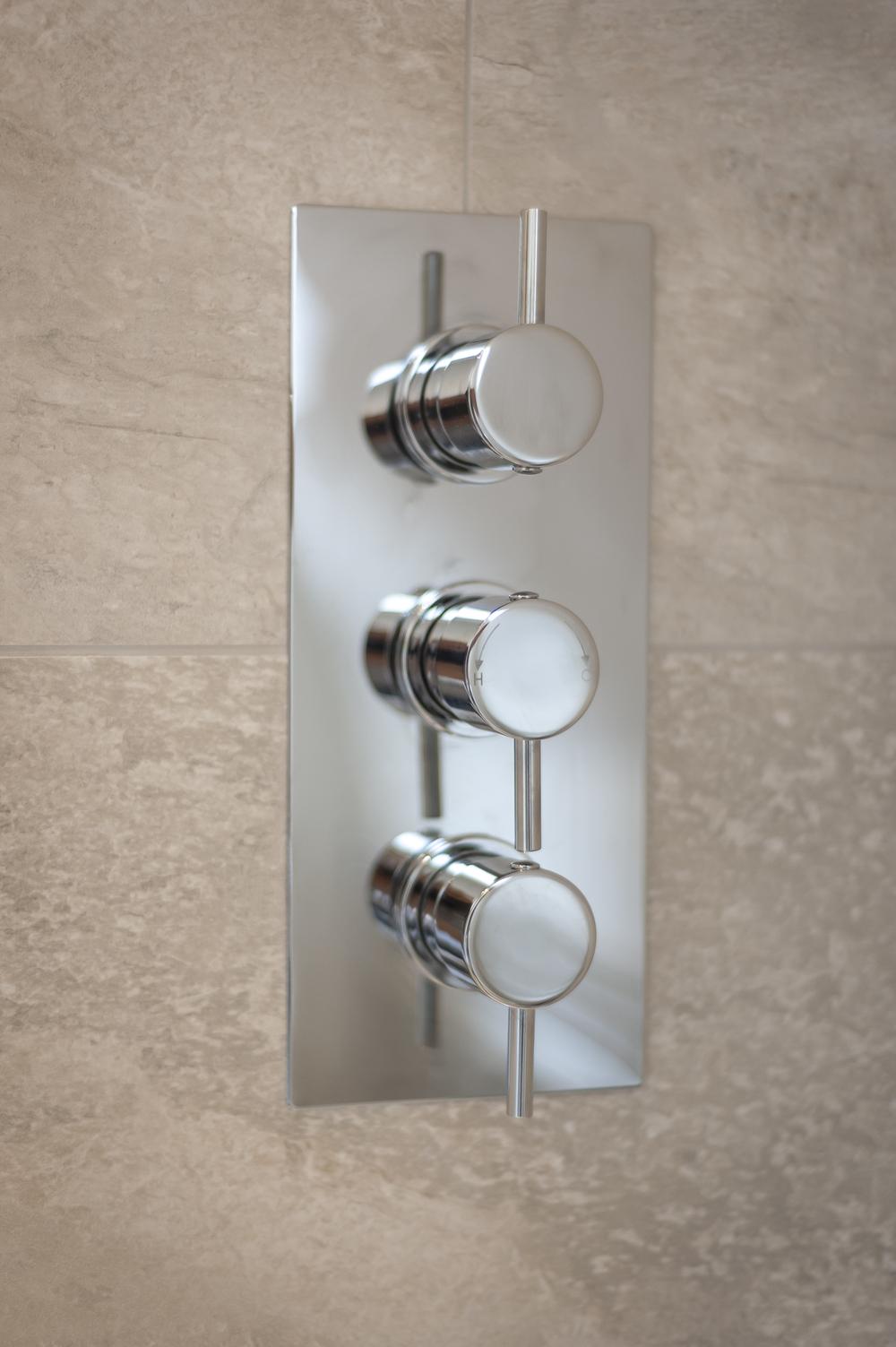 Shower Controls against Limestone Tiles