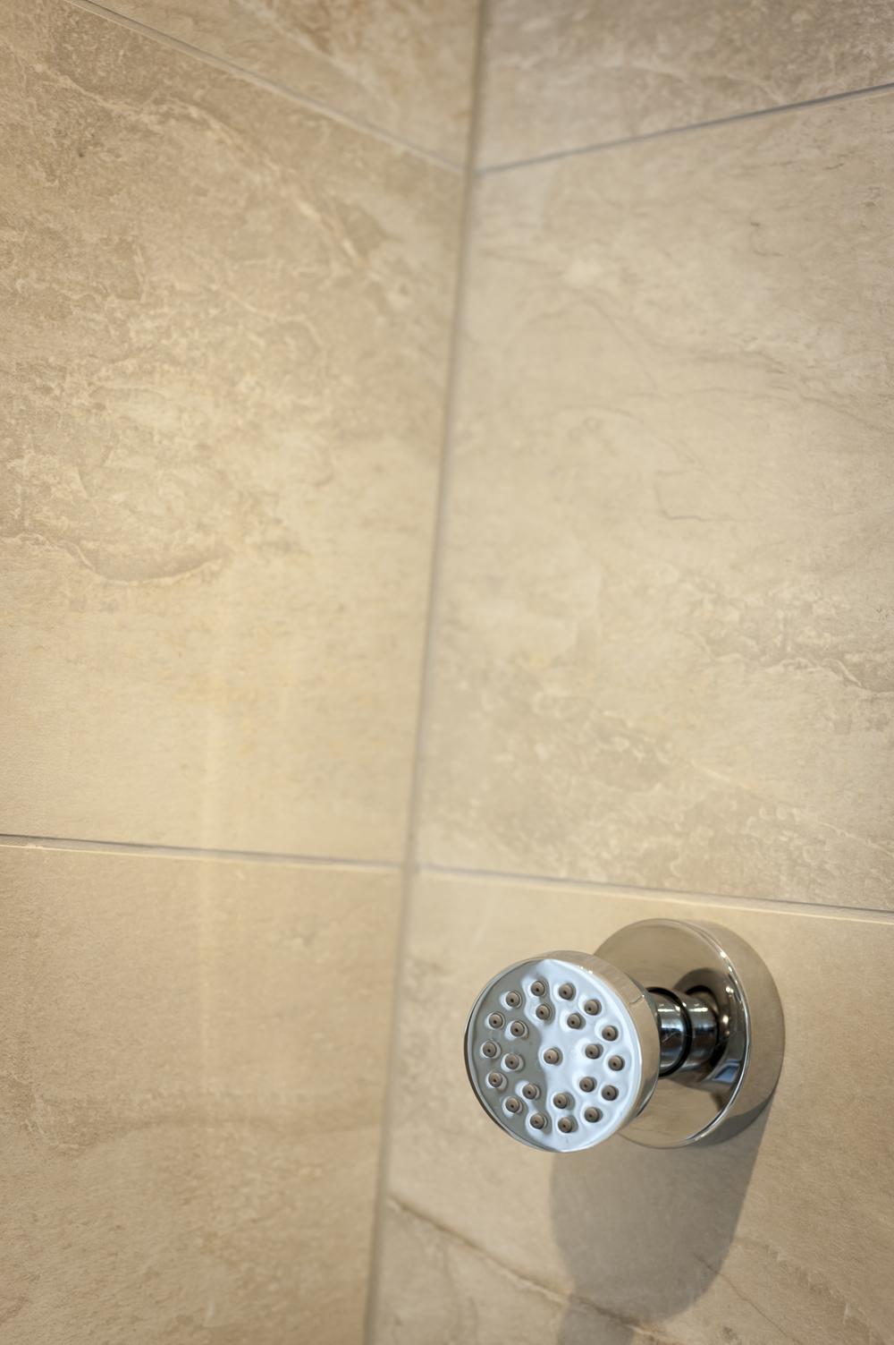 Body Jet against Limestone Tiles