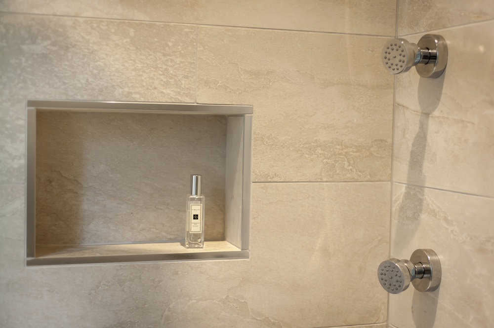 Walk-in Shower with Body Jets against Limestone Tiles