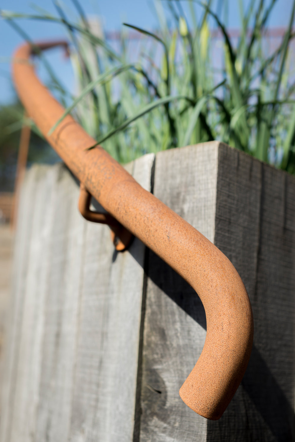 Weathered Oak Post Retaining Wall with Rusted Steel Hand Rail