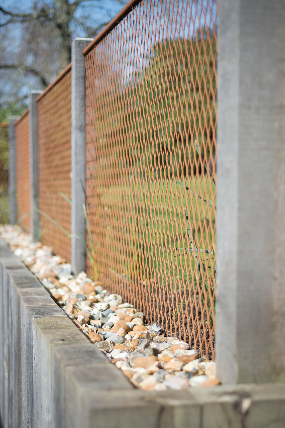 Oak Post and Mesh Fence set on Retaining Wall