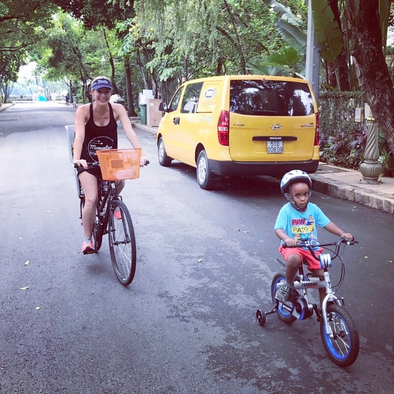 Ness (7 months pregnant) with Tomas, off for a bike ride around the block